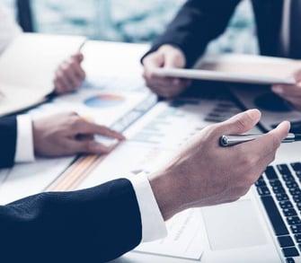 photo-sliver-business-adviser-analyzing-financial-figures